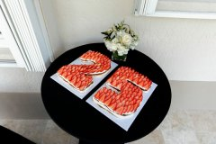decorated table with cakes covered in strawberries that spell out 25